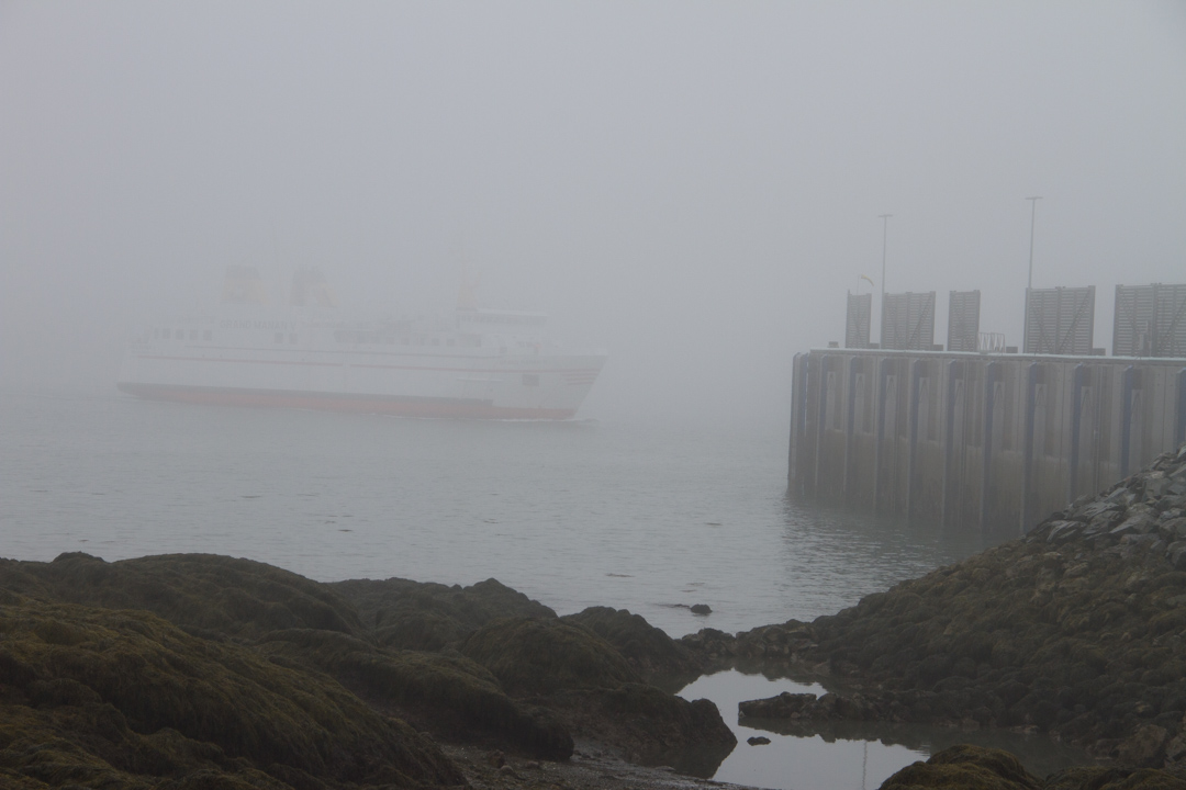 Barely-visible Grand Manan ferry makes dock