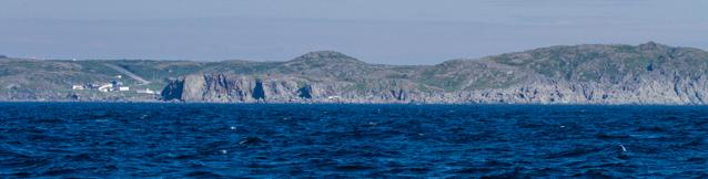 The tiny town of Saint Carols, huddled aqainst the cliffs.