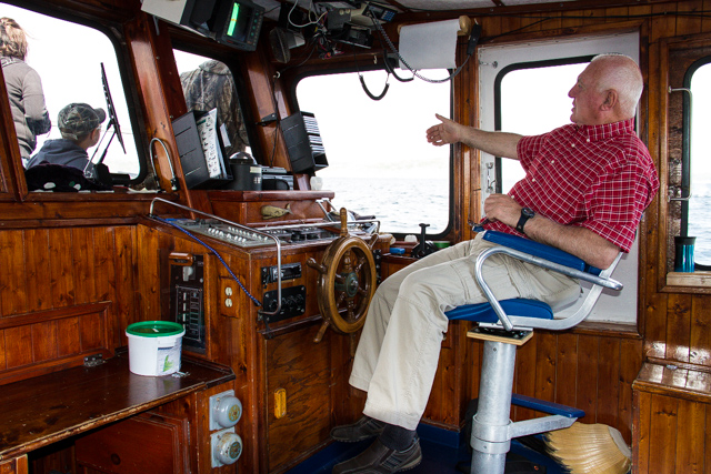Captain Alcock at the helm