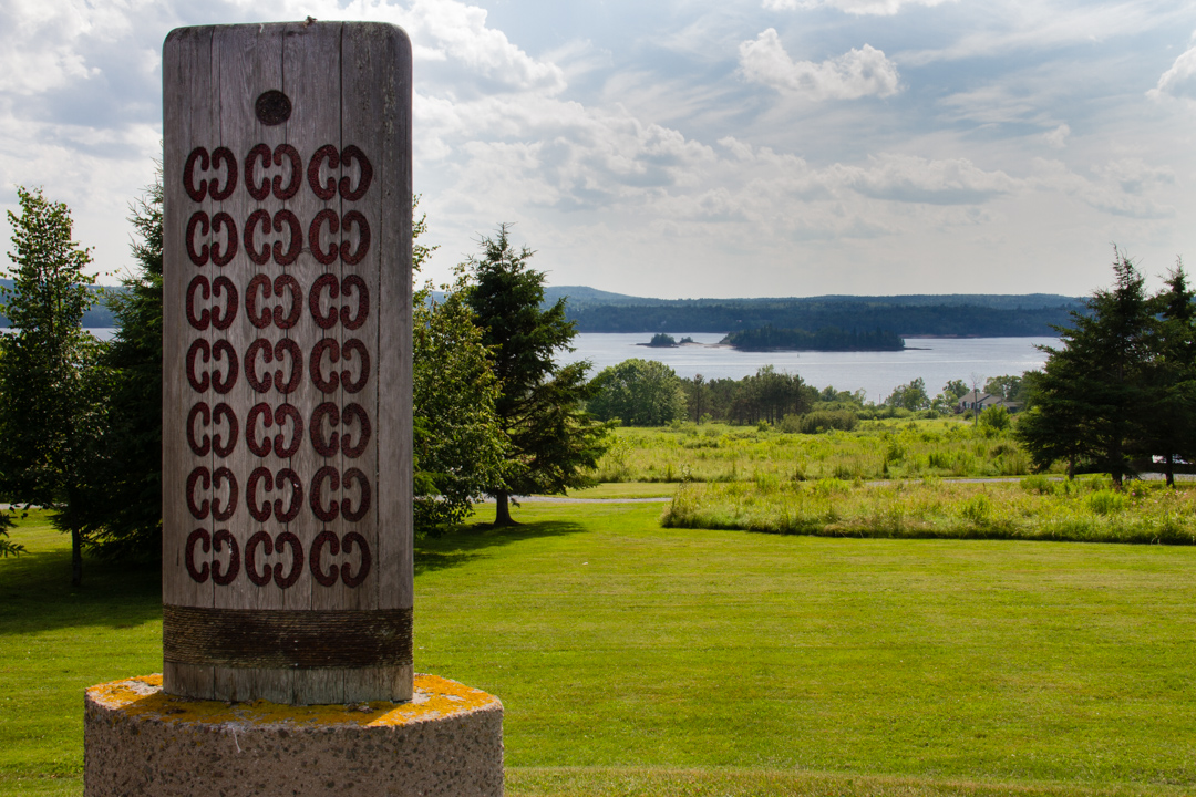 'Wuli ta has wugnul' sculpture with St. Croix Island in the background